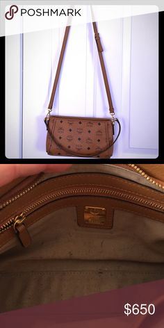 MCM crossbody Bought only a month ago!!! Real MCM bag bought from the MCM store in the mall. A lot of room inside with two pockets(one with a zipper). Only used a couple times. Adjustable shoulder strap. Can be worn with anything!!!! REAL LEATHER AND WATER PROOF!!! MCM Bags Crossbody Bags