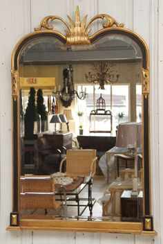 31x46 1950+ Neoclassical Gilt Ebonized Mantel Mirror | From a unique collection of antique and modern pier mirrors and console mirrors at http://www.1stdibs.com/furniture/mirrors/pier-mirrors-console-mirrors/