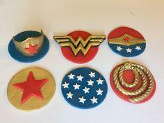 A personal favorite from my Etsy shop https://www.etsy.com/listing/523571726/wonder-woman-inspired-cake-toppers