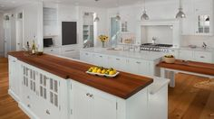 Beautiful white kitchen with double islands