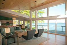 Lakeview - Architect: Dan Feidt Architect Firm: Dan Feidt Studio Location: Deephaven, MN Project Type: Remodel This scenic lakeside home is a remodel of a 1960s walkout. The builders, who are also the homeowners, had two simple goals for the design: create a magnificent view of the lake, and improve energy efficiency. They began the remodel by inverting the roofline with two large butterfly dormers, creating a two-story wall of windows facing the lake in back. Remotely operable windows were…