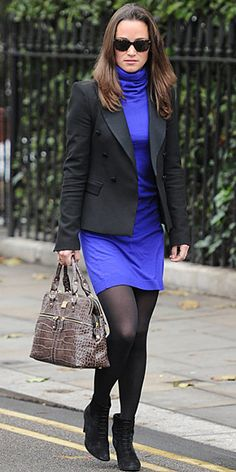 Pippa Middleton threw a black blazer over a cobalt turtleneck dress. She paired the look with semi-sheer tights and suede Kate Kuba lace-up booties.