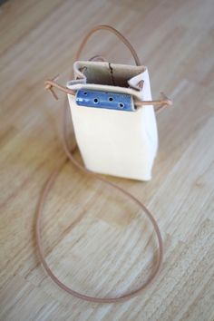 DIY: leather pouch just big enough for small wallet, phone and keys