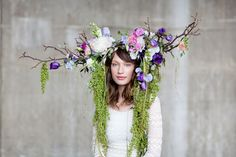 Floral head dress sculpture made from English flowers - magnolia twigs, lisianthus, peonies, sweet peas, honesty, sorrel and grasses in lime green, purple, pinks, pastel shades. Fashion design for British Flowers Week 2014 by Okishima & Simmonds