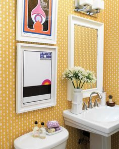 Vintage Spanish movie posters have a graphic pop-art appeal against yellow wallpaper.