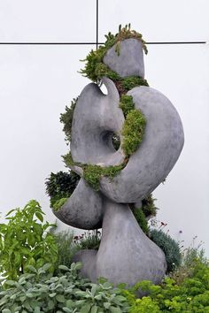 Sculpture mixed in with surrounding landscape.