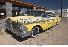 1958 yellow Edsel with dummy driver parked in Seligman Arizona off Route 66 - Stock Image - B2Y0TA - https://www.linkedin.com/pulse/finallyhere-jan-ovland - enjoy !  - janovland@gmail.com