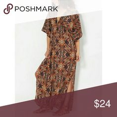 Paisley tunic dress This is a Paisley tunic dress with plunging neckline it is 100% polyester has two splits on each side also has two halter strings to tie in the back colors are navy blue tan Coral get ready for the great weather ahead ladies bundle two items and receive a discount Dresses