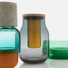 London designer Mathias Hahn added concrete, brass and metal to these coloured glass vessels, which are inspired by making jam.
