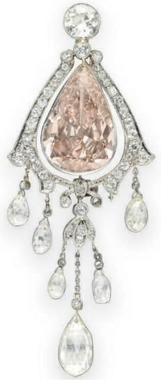 Belle Epoque diamond and colored diamond brooch, circa 1910. Center diamond is a pear-shaped fancy brownish pink diamond weighing approximately 5.83 carats. Via Diamonds in the Library.