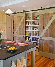 Pantry With Sliding Barn-style Doors:  24 Must See Decor Ideas to Make Your Kitchen Wall Looks Amazing