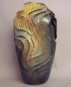 Ceramic art is created when traditional hand crafted forms are carved and richly glazed by Denise Brown. Each piece of fine art pottery is one-of-a-kind and unique. The organic and fluid patterns offer surfaces that beg to be touched and admired. Award winning pottery that must be seen in person to be appreciated