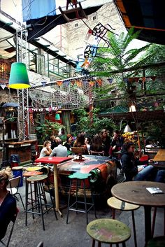 Szimpla Kert Ruin Bar, Budapest. Especially the cut in half bath tubs for chairs and computers hanging from the ceiling