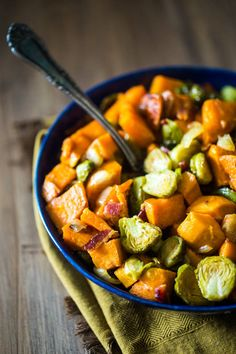 Paleo Maple Roasted Brussels Sprouts, Sweet Potatoes and Bacon - A gluten free, healthy side dish with only 5 ingredients, that is easy to make! Perfect for Thanksgiving or Christmas! | Foodfaithfitness.com | @FoodFaithFit