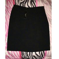 Black business skirt Never been worn, excellent condition. Little ruffle type design in front, short zip in back. Satin lined in the inside pencil skirt design, and no stretch. Petite size Skirts Pencil