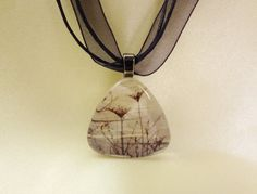 We now carry beautiful handmade jewelry from local artist Julie Freeney. She takes pictures of pictures that she's painted and makes great pendants and earrings out of them.