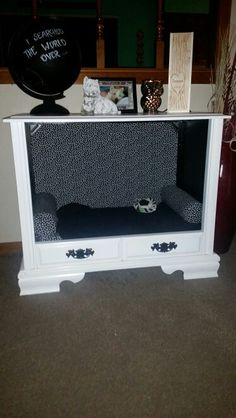 Old console tv, transformed into a dog bed..