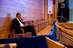 President Obama writing his Newtown address in the audience of Sasha's ballet rehearsal.