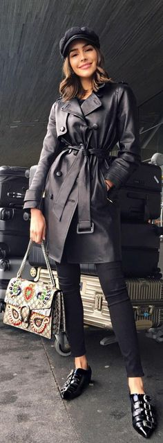 Who made Olivia Culpo's black trench coat, buckle shoes, and tan print handbag?