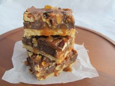 Gooey Caramel Twix Bars - Not your average bar cookie. Crunchy Twix bars, pecans, bittersweet chocolate, and a homemade caramel all set over a buttery shortbread crust.