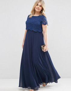 rochii de seara pentru femei plinute. Este o rochie lunga bleumarin cu maneci scurte si top dantela