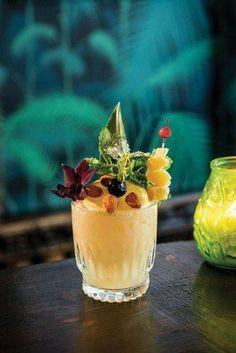 Polynesian Remedy 1¾ oz. dark rum (Plantation) ½ oz. orgeat ½ oz. ginger syrup ½ oz. honey syrup (1:1) 1 oz. fresh lemon juice 4 dashes smoky single-malt scotch Garnish: candied ginger, lemon wheel and pineapple leaf