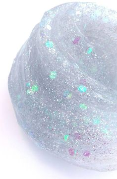 *** PLEASE NOTE: This listing is for 5 ounces of product that will come to you in a 6 ounce container *** COLOR: Fairytale Ending is a clear slime with lots of tiny iridescent glitters and larger iridescent glitters. TEXTURE: Fairytale Ending is a clear glue slime. WHAT YOU