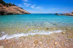 Ibiza Cala Moli beach with clear water in Balearics #photodune