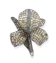A CHRYSOBERYL, TSAVORITE GARNET AND COLORED DIAMOND BROOCH, BY ANDREA MOLINARI Designed as a pavé-set chrysoberyl iris bloom, with circular-cut tsavorite garnet veining and leaves, to the pavé-set brown diamond stem, mounted in silver and gold Signed Andrea Molinari, Iris No. 3  The colored diamonds have not been tested for natural color origin