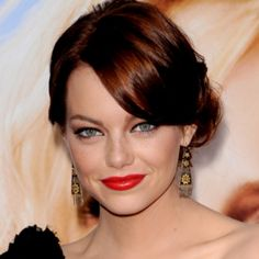 <p>Emma Stone's got the right idea with this loose, wavy chignon. Perfect for a night out, this hairstyle is easy to complete thanks to The Daily Makeover's instructions. </p>