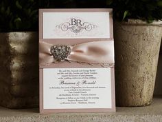 who could say no to a beautiful ivory lace and blush satin ribbon wedding invitation like this one? not to mention brooches are a vintage lover's best friend