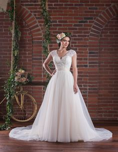 """A-line wedding dress with lace bodice with V-neckline and lace cap sleeves. V-back and tulle skirt.  """"Inlow"""" by Emmaline Bridal, Spring 2016 collection"""