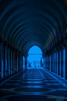 The blue light before dawn filters through the columns supporting the arcade beneath the Doge's Palace in St. Mark's Square.