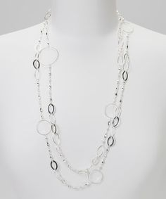 Treat an ensemble to a shot of sophisticated style with this elegantly long necklace. Showcasing a selection of hammered circles, the delicate design suits a dozen different looks all the way from casual to classy.