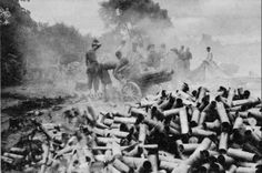 US 75-mm howitzer crew firing at Japanese positions in Myitkyina, Burma, June 1944