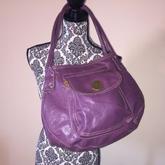 "Axcess bag It's a purple bag with a inside zipper closure and a front pocket snap closure. It has a little wear on one of the handles with gold hardware. It measurements are 13"" by 13"". Axcess Bags Shoulder Bags"