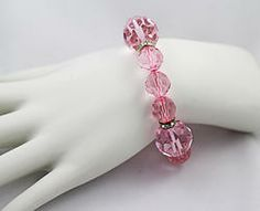 $7.00 - Glass Beads. Glass bead bracelet accented with crystal spacers on PINK stretch cord. One size fits most.  #PINKBracelets #PINK #Bracelets #PINKPixie #Nonprofit    All of our proceeds go to educating women in crisis. www.pinkpixie.org