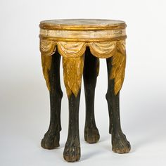 "Tara Shaw TARA SHAW MAISON - ITALIAN FOOTED TABLE ZEBRA LEGS    Stunning Italian Footed Table with Zebra legs    Measurements:    20½""h x diameter: 15¼"" @ feet / 14"" @ top    Free Shipping  Price:  $1,125.00"