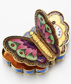 A fine and rare gold and enamel butterfly-form musical Snuff Box with watch, Piguet & Meylan, by Georges Reymond, 1820, Sotheby's.
