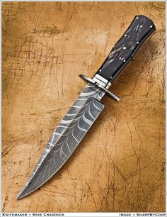 Mike Craddock coffin handled bowie A Damascus blade is a nice accent to any outfit.