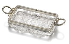 A Fabergé silver and glass dish, Moscow, 1908-1917, the base cut with star facets, the rim moulded with bound reeds, ribbon and wreath handles.