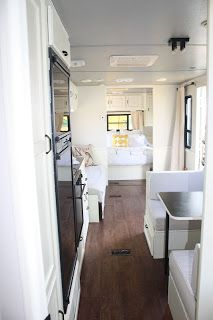 RV redo in white and grey, love the flooring, love the countertops, they used rustoleum tinted black.