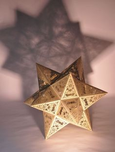 http://www.suzettemacgregor.com/  Laser cut Stellated dodecahedron