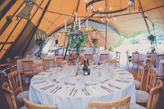 Jack and Corinne's tipi take on a classy and classic wedding with touches of vintage style. August 2013 at Duncton, West Sussex. Photography by katecooperphotography.blogspot.co.uk