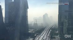 Timelapse: Smog envelopes Beijing in minutes