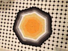 Tee shirt yarn crochet rug.