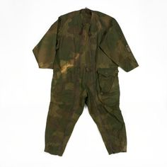 "Jump Suit,  ""SOE Striptease Suit"": SOE. Allied agents of the SOE that were parachuted into occupied territory were issued with a set of protective overalls and a fabric jump helmet, both made of a distinctive and unique camouflage pattern. Intended to be used only once, they were buried or otherwise disposed of when landed alongside the parachute; the agent then went along on his or her way clothed in civilian attire to blend in anonymously."