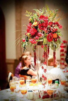 Tall reception arrangement including hanging amaranthus, dahlias, gerbera daisies, tulips, seeded eucalyptus..