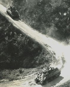 WWII tanks rumble down Burma Road. Photographer Unknown