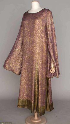 "BABANI LAVENDER LAME DRESS, 1928-1930 - Deco rose & leaf patterned gold lame, angel wing sleeves, 6 hem gores in black & gold lame pinstripe, sleeves & neckline bound in gold cord, ""Babani 98 Bd Hausmann Paris"" label"